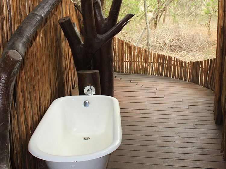 Ihlozi Bush Lodge Outdoor Ensuite Shower, bath and toilet